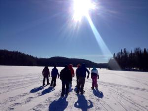 Snowshoeing on a frozen lake