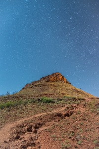 Big Bruce, a long exposure with the moon lighting the foreground, stars in the background